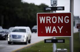 wrong way on a one-way street or rotary traffic island